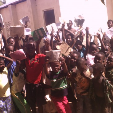 Picture of teachers and the students and the feeding program and classes